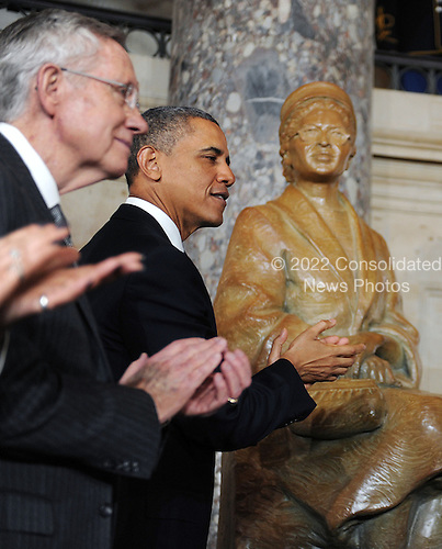 United States President Barack Obama, right, and U.S. Senate Majority Leader Harry Reid (Democrat of Nevada), left, look on during the unveiling of a statue of Rosa Parks in Statuary Hall of the United States Capitol February 27, 2013 in Washington, DC..Credit: Olivier Douliery / Pool via CNP