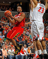 Maryland guard/forward Dez Wells (32) shoots next to Virginia  defenders during the game Sunday in Charlottesville, VA.  Photo/Andrew Shurtleff