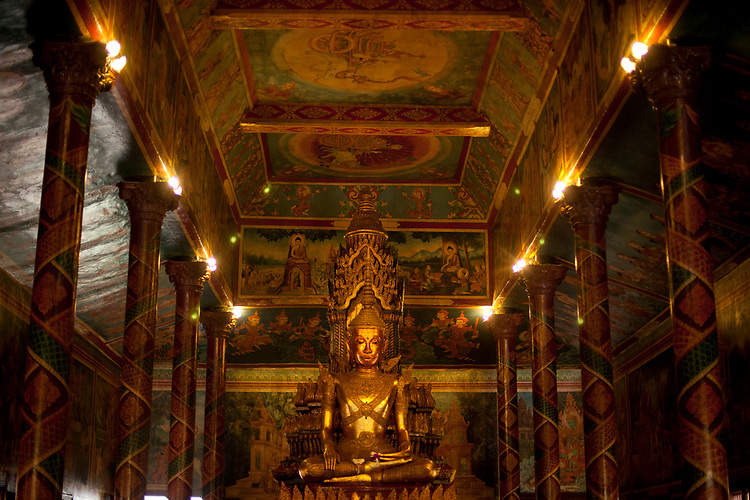 Famous gold buddha at Wat Phnom temple Phnom Penh, Cambodia. <br /> <br /> Photos &copy; Dennis Drenner 2013.