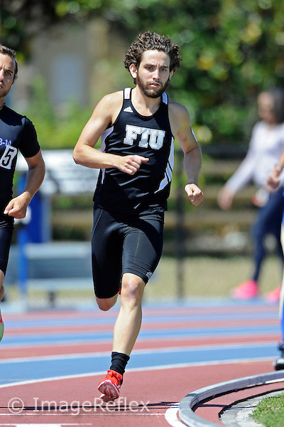 14 March 2013:  FIU's Miguel Delgadillo (2) competes in the 800 meter run at the FIU Felsberg Invitational track meet at the Ansin Sports Complex in Miramar, Florida.