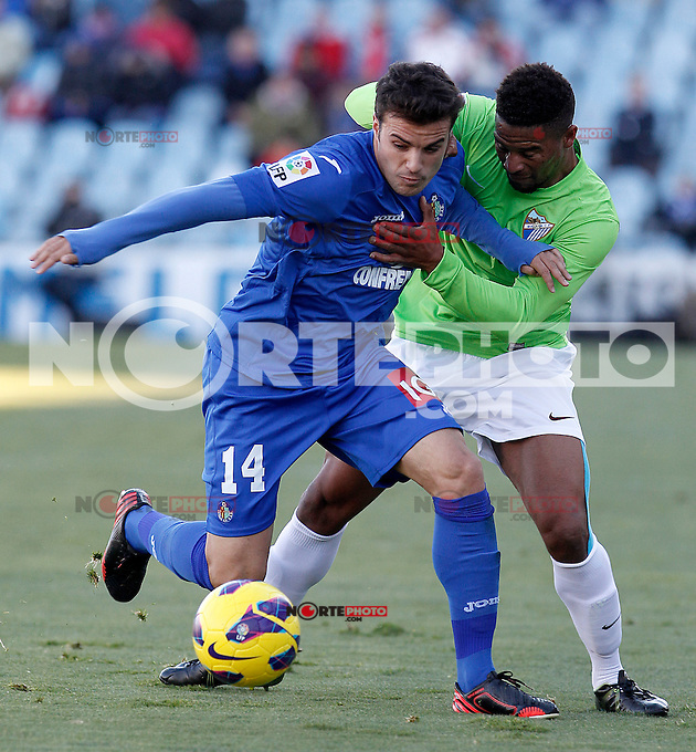 Getafe's Pedro Leon (l) and Malaga's Eliseu Pereira during La Liga match.December 01,2012. (ALTERPHOTOS/Acero) ©/NortePhoto