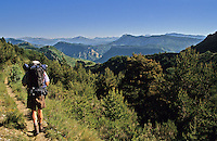 Backpacker/hiker walking in Alpes de Haute Provence near Le Poil between Verdon and Digne. France..