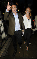Richard Merkell & Patsy Palmer.attended the Kensington Club new boutique nightclub launch party, The Kensington Club, High Street Kensington, London, England,.20th July 2012..full length husband wife couple brown suit jacket blue shirt black trousers white top leggings hand gesture .CAP/CAN.©Can Nguyen/Capital Pictures.