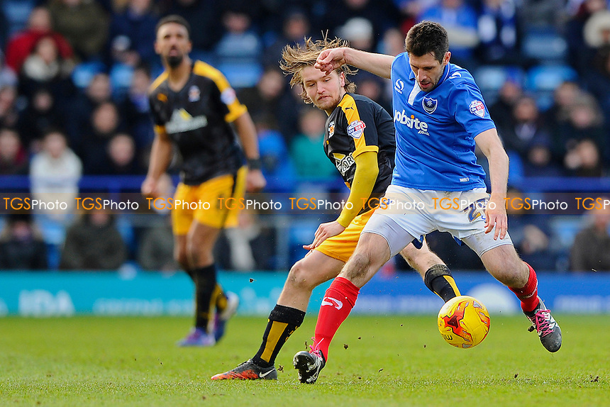 Danny Hollands of Portsmouth right holds off Luke Berry of Cambridge United during Portsmouth vs Cambridge United, Sky Bet League 2 Football at Fratton Park, Portsmouth