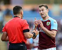 Burnley's Ashley Barnes pleads innocence to referee Istvan Kovacs<br /> <br /> Photographer Alex Dodd/CameraSport<br /> <br /> UEFA Europa League - Third Qualifying Round 2nd Leg - Burnley v Istanbul Basaksehir - Thursday 16th August 2018 - Turf Moor - Burnley<br />  <br /> World Copyright © 2018 CameraSport. All rights reserved. 43 Linden Ave. Countesthorpe. Leicester. England. LE8 5PG - Tel: +44 (0) 116 277 4147 - admin@camerasport.com - www.camerasport.com