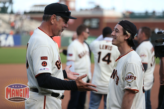 SAN FRANCISCO, CA - SEPTEMBER 29:  Retiring manager Bruce Bochy #15 of the San Francisco Giants talks with former player Tim Lincecum after a ceremony to celebrate Bochy's career following the game between the Los Angeles Dodgers and the San Francisco Giants at Oracle Park on Sunday, September 29, 2019 in San Francisco, California. (Photo by Brad Mangin)