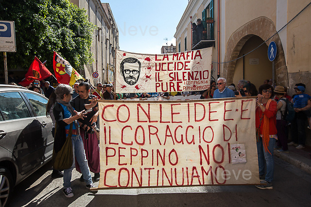Terrasini.<br /> <br /> Cinisi / Terrasini, (Palermo, Sicily), 09/05/2018. Today, thousands of people gathered in Terrasini, outside &quot;Radio Aut&quot;, to hold a 'Corteo' (march) which ended outside &quot;Casa Memoria Felicia e Peppino Impastato&quot; in Cinisi. The demonstration marked the 40th Anniversary of the murder of the antimafia Journalist and Political Activist Giuseppe 'Peppino' Impastato (30), who was killed on the 9th May 1978 by Cosa Nostra (the Sicilian mafia organization) lead by Cinisi boss Tano Badalamenti (https://bit.ly/2KWO6DY). The coloured-inclusive crowd reached Impastato's home in Cinisi, where a rally took place attended, amongst others, by Pappino Impastato's brother Giovanni, Susanna Camusso (Italian Trade Unionist and General Secretary of the CGIL), Giovanni Russo Spena (Italian politician, Left), Adelmo Cervi, Don Luigi Ciotti (Italian Catholic priest, in 1995 he started the association Libera, in charge of coordinating the effort of various Italian organizations against organized crime - http://bit.ly/2uLiLxV), Lirio Abate (Anti-mafia Journalist), Giuseppe Giulietti (Presidente della Federazione Nazionale Stampa Italiana, FNSI - President of the Italian National Press Federation) and by several friends, families of mafia's victims and supporters of Peppino.<br /> <br /> For more info about Peppino Impastato click here: http://www.centroimpastato.com/english/ &amp; http://bit.ly/2iSauUS &amp; http://bit.ly/2xHgyTG &amp; https://bit.ly/2KjdVwF &amp; https://bit.ly/2rCkkw5 (Wikipedia Article about Marco Tullio Giordana's film: &quot;I Cento Passi&quot;)<br /> <br /> To watch &quot;Felicia - La Mafia Uccide Il Silenzio Pure&quot; click here (Italian only - Source Telejato.it): http://bit.ly/2guzYTL<br /> <br /> Two songs dedicated to Peppino Impastato: (Modena City Ramblers - I Cento Passi) https://bit.ly/1hbx5DX &amp; (Annalisa Insard&agrave; - E Sale Quanto Basta) https://bit.ly/2xHhOWK