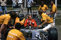 BOWMANVILLE, ONT - JUNE 14: Dan Gurney, in the McLaren M8D 3/Chevrolet, speaks with crew chief/team manager Tyler Alexander (right) before practice for the Labatt's Blue Trophy SCCA Can-Am race at Mosport Park near Bowmanville, Ontario, Canada, on June 14, 1970. Gurney was the fastest qualifier and won the race, replacing team founder Bruce McLaren who had been killed in a crash 12 days earlier.