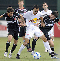 US Open Cup Quarterfinal, Red Bulls forward Youri Djorkaeff (10) fights for possession of the ball and is defended by United's Facundo Herpen (5), right, and Ben Olsen (14), left. DC United defeated the New York Red Bulls 3-1 ,Wednesday, August 23, 2006 at RFK Stadium.