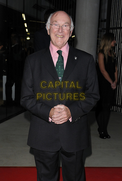 Murray Walker .attending the McLaren Automotive Showroom Launch at One Hyde Park, Knightsbridge, London, England, UK, June 21st 2011..half length pink shirt green tie black suit glasses smiling .CAP/CAN.©Can Nguyen/Capital Pictures.