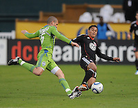DC United midfielder Andy Najar (14) goes against Seattle Sounders midfeidler Osvaldo Alonso (6)  DC United defeated The Seattle Sounders 2-1 at  RFK Stadium, Wednesday May 4, 2011.