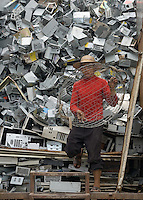 A worker packs the casings og old computers on to the back of a truck in Guiyu in southern China's Guangdong province.  Each year, between 20 and 50 million tons of electronic waste is generated globally. Most of it winds up in the developing world. Some of the most popular destinations for dumping computer hardware include China, India, and Nigeria. It can be 10 times cheaper to ship waste to China than to dispose of it properly at home. With the market for e-waste expected to top $11 billion by 2009, it's lucrative to dump on the developing world.