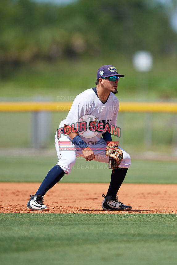 GCL Rays second baseman Cristhian Pedroza (19) during a game against the GCL Twins on August 9, 2018 at Charlotte Sports Park in Port Charlotte, Florida.  GCL Twins defeated GCL Rays 5-2.  (Mike Janes/Four Seam Images)