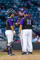 Winston-Salem Dash pitching coach J.R. Perdew (31) has a chat with starting pitcher Carlos Rodon (26) and catcher Omar Narvaez (21) during the game against the Lynchburg Hillcats at BB&T Ballpark on August 13, 2014 in Winston-Salem, North Carolina.  The Hillcats defeated the Dash 4-3.   (Brian Westerholt/Four Seam Images)