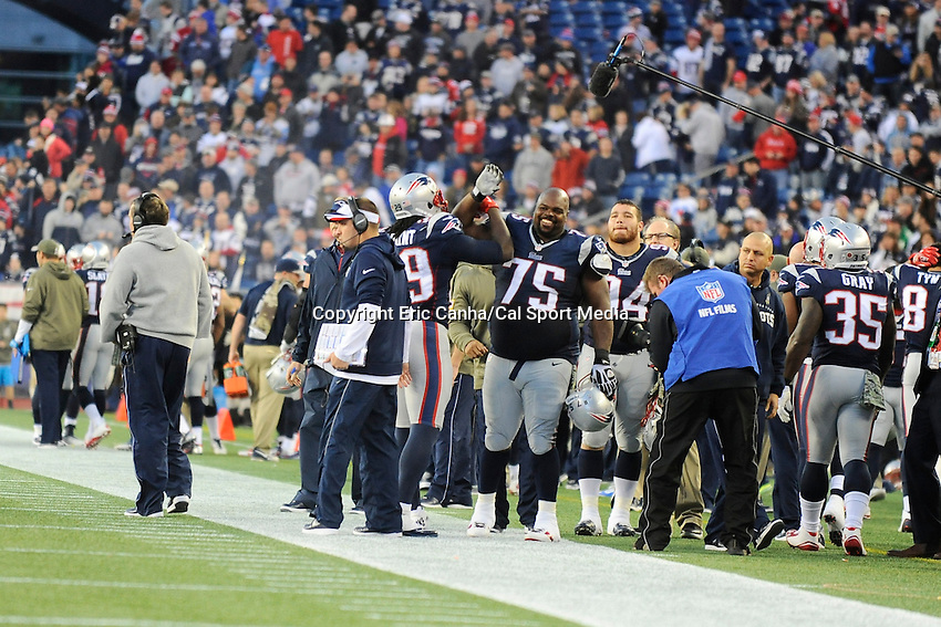 November 23, 2014 - Foxborough, Massachusetts, U.S.- New England Patriots defensive tackle Vince Wilfork (75) high-fives running back LeGarrette Blount (29) during the NFL game between the Detroit Lions and the New England Patriots held at Gillette Stadium in Foxborough Massachusetts. The Patriots defeated the Lions 34-9. Eric Canha/CSM