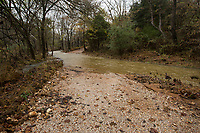 NWA Democrat-Gazette/BEN GOFF @NWABENGOFF<br /> Water flows over a washed-out section Thursday, Nov. 7, 2019, on Wendell Jones Road in Benton County.