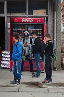 Serbia. Veliki Trnovac (in Albanian: Tërnoc i Madh) is a town in the municipality of Bujanovac, located in the Pčinja District of southern Serbia. A group of Albanian teenagers on their way to school play with their mobile phones. They stand on the road near a Coca Cola machine which sells from a fridge all kind of different beverages, such as bottles of water, Coca-Cola, Fanta , Sprite, Iced Tea, … Street life. Bujanovac is located in the geographical area known as Preševo Valley. The Pestalozzi Children's Foundation (Stiftung Kinderdorf Pestalozzi) is advocating access to high quality education for underprivileged children. It supports in Bujanovac a project called » Our towns, our schools ». 16.4.2018 © 2018 Didier Ruef for the Pestalozzi Children's Foundation