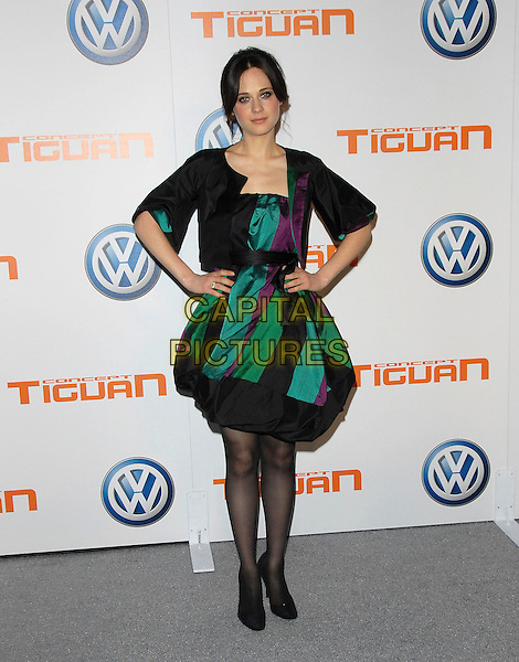 ZOOEY DESCHANEL.attends Volkswagen US Premiere of Concept Tiguan held at Raleigh Studios in Los Angeles, California, USA,.November 28, 2006..full length black green blue purple patterned dress puffy skirt tights shoes hands on hips.CAP/DVS.©Debbie VanStory/Capital Pictures
