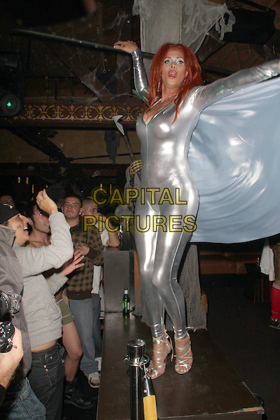 CANDIS CAYNE .Bacardi Hosts Halloween at The Abbey, West Hollywood, California, USA, .31 October 2008..full length silver catsuit shiny wings costume dancing on table bodysuit .CAP/ADM/FS.©Faye Sadou/Admedia/Capital Pictures