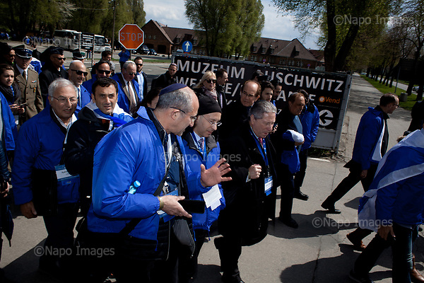 OSWIECIM, POLAND, APRIL 24, 2017:<br /> Elisha Wiesel, center right and Steve Jackson are walking in the &quot;March of The Living&quot; an annual march between two camps of the Auschwitz concentration camp.  Elisha Wiesel is a chief technology officer at Goldman Sachs in New York and the only son of Holocaust memoirist Eli Wiesel. After death of his father he has decided to step forward and take a more public role, carrying on his father's work.<br /> (Photo by Piotr Malecki / Napo Images)<br /> ###<br /> OSWIECIM, 24/04/2017:<br /> Elisha Wiesel, syn slawnego Eli Wiesela, bierze udzial w Marszu Zywych w Oswiecimiu. Po smierci ojca Elisha postanowil kontynuoawc jego dzielo.<br /> Fot: Piotr Malecki / Napo Images<br /> <br /> ###ZDJECIE MOZE BYC UZYTE W KONTEKSCIE NIEOBRAZAJACYM OSOB PRZEDSTAWIONYCH NA FOTOGRAFII###