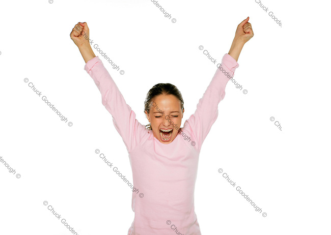 With hands up high in the air, a teen girl yells out in excitement about her team win.