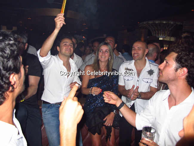 Felipe Massa and wife Rafaela Bassi Massa..Brazilian F1 Driver, Felipe Massa partying with friends in St Tropez..Les Caves Du Roy Nightclub..St Tropez, France..Saturday, July 16, 2011..Photo By CelebrityVibe.com..To license this image please call (323) 325-4035 ; or.Email: CelebrityVibe@gmail.com ;.website: www.CelebrityVibe.com