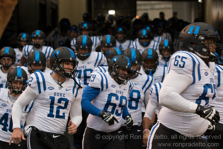 The Duke football team takes the field. The Pitt Panther defeated the Duke Blue Devils 56-14 at Heinz Field in Pittsburgh, Pennsylvania on November 19, 2016.