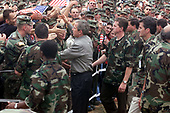 United States President George W. Bush shakes hands with  American soldiers during his  visit to Camp Bondsteel in Kosovo on July 24, 2001. Bush is visiting the Task Force Falcon soldiers to show support for the troops in Kosovo.  The president signed the fiscal year 2001 Emergency Supplemental Appropriations legislation which contains $1.9 billion for military pay, benefits and health care among other categories during his visit.  <br /> Mandatory Credit: Clinton J. Evans / U.S. Army via CNP
