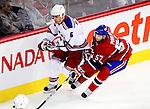 23 January 2010: New York Rangers' defenseman Wade Redden is checked by Montreal Canadiens left wing forward Benoit Pouliot during a game at the Bell Centre in Montreal, Quebec, Canada. The Canadiens shut out the Rangers 6-0. Mandatory Credit: Ed Wolfstein Photo