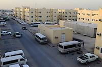 QATAR, Doha, housing complex for migrant worker outside the city / KATAR, Doha, Gastarbeiter, Sammelunterkunft fuer Gastarbeiter ausserhalb der Stadt