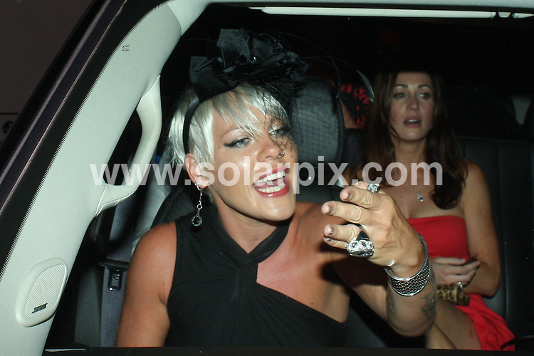 **ALL ROUND PICTURES FROM SOLARPIX.COM**.**WORLDWIDE SYNDICATION RIGHTS**.**NO PUBLICATION IN AUSTRALIA, NEW ZEALAND, DENMARK, GERMANY OR USA**.The pop star Pink seen leaving the Madeo restaurant with friends in Beverly Hills in the front passenger side of a car upon departure, a car from the street blocked Pinks exit from the garage area so Pink expressed her displeasure by jumping over to the drivers side and gave the one finger salute ! She looked extremely angry and let the other driver know how mad she was.she then proceeded to light up a cigarette  to calm down...JOB REF:7267-LAP/SSCW       DATE:09_09_08 .**MUST CREDIT SOLARPIX.COM OR DOUBLE FEE WILL BE CHARGED* *UNDER NO CIRCUMSTANCES IS THIS IMAGE TO BE REPRODUCED FOR ANY ONLINE EDITION WITHOUT PRIOR PERMISSION*