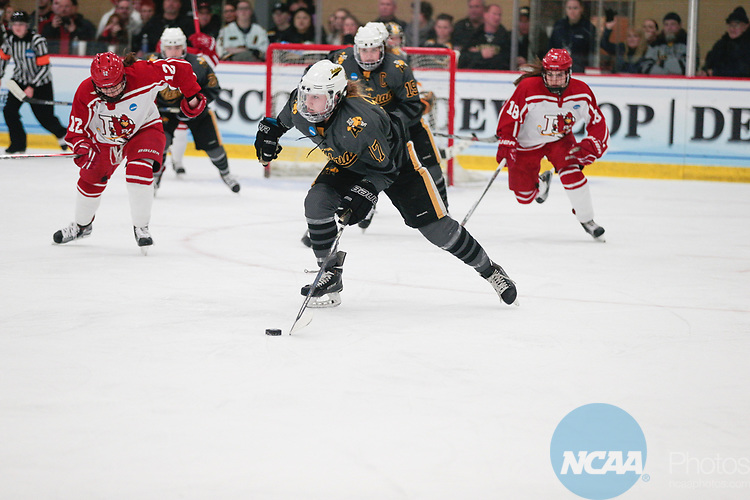 ADRIAN, MI - MARCH 18: Brooke Lupi (17) of Adrian College skates with the puck during the Division III Women's Ice Hockey Championship held at Arrington Ice Arena on March 19, 2017 in Adrian, Michigan. Plattsburgh State defeated Adrian 4-3 in overtime to repeat as national champions for the fourth consecutive year. by Tony Ding/NCAA Photos via Getty Images)