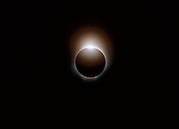 Diamond ring effect. The sun emerging from behind the moon at the end of a total solar eclipse.