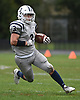 Thomas Flavin #3 of Oceanside rushes for a gain during the second quarter of a Nassau County Conference I varsity football game against host Baldwin High School on Saturday, Oct. 6, 2018. Oceanside won by a score of 35-0.