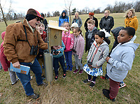 NWA Democrat-Gazette/ANDY SHUPE<br /> Rick Jones of Fayetteville shows a bluebird house Thursday, March 14, 2019, to a group of students from Butterfield Trail Elementary School who were on a field trip to learn about birds at the Botanical Garden of the Ozarks. Gifted and talented students from Fayetteville Public Schools spent the day at the gardens learning about ornithology through instruction from garden volunteers and district teaching staff.