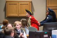 NWA Democrat-Gazette/BEN GOFF @NWABENGOFF<br /> Denia Calix, playing the bailiff, takes Benedict Arnold, played by Tristan Hash, into custody after Arnold was found guilty of treason Wednesday, March 7, 2018, as 5th grade students from Frank Tillery Elementary in Rogers hold a mock trial at Rogers District Court. The students put on costumes and portrayed historical figures from the American Revolution, putting Benedict Arnold on trial for treason and Capt. Thomas Preston on trial for murder in the Boston Massacre.