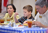 STAFF PHOTO BEN GOFF  @NWABenGoff -- 09/28/14 Drew Moguin, 10, desert during a meal at First United Methodist Church served by volunteers with Samaritan Community Center as a way for church members to learn about the center and it's work on Sunday September 28, 2014. Children in attendance were served just one bowl of rice as a first course as a way of helping them apreciate the hunger problem in Northwest Arkansas.
