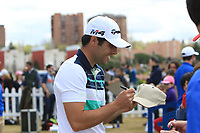 Adrian Otaegui (ESP) signing a cap after Round 3 of the Open de Espana 2018 at Centro Nacional de Golf on Saturday 14th April 2018.<br /> Picture:  Thos Caffrey / www.golffile.ie<br /> <br /> All photo usage must carry mandatory copyright credit (&copy; Golffile | Thos Caffrey)