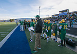 Bishop Manogue Miners  head coach Ernie Howren works the side lines against Arbor View Aggies in the NIAA 4A State Semi-Final football game played at McQueen High School on Saturday, Nov. 24,2018.