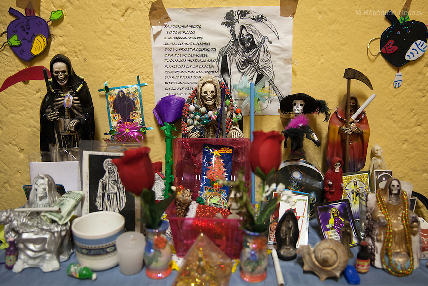 An altar of candles and offerings for the Santa Muerte (Saint Death) seen in the bedroom of Patricia, a resident of Casa Xochiquetzal, at the shelter in Mexico City, Mexico on September 2, 2013. Casa Xochiquetzal is a shelter for elderly sex workers in Mexico City. It gives the women refuge, food, health services, a space to learn about their human rights and courses to help them rediscover their self-confidence and deal with traumatic aspects of their lives. Casa Xochiquetzal provides a space to age with dignity for a group of vulnerable women who are often invisible to society at large. It is the only such shelter existing in Latin America. Photo by Bénédicte Desrus