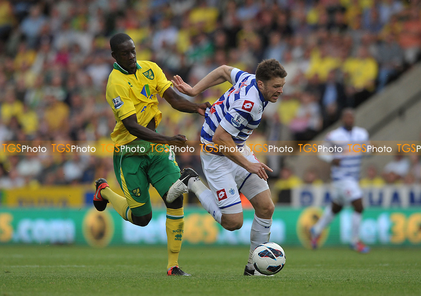 Leon Barnett of Norwich City and Jamie Mackie of Queens Park Rangers - Norwich City vs Queen's Park Rangers - Barclays Premier League Football at Carrow Road, Norwich, Norfolk -25/08/2012 - MANDATORY CREDIT: Martin Dalton/TGSPHOTO - Self billing applies where appropriate - 0845 094 6026 - contact@tgsphoto.co.uk - NO UNPAID USE.