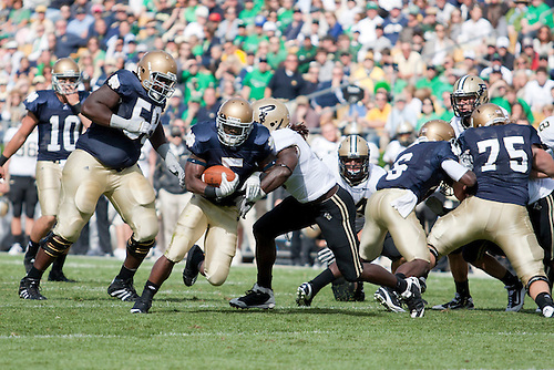 Notre Dame inside tailback Armando Allen (#5) breaks through the line in game action during NCAA football game between the Notre Dame Fighting Irish and the Purdue Boilermakers.  Notre Dame defeated Purdue 23-12 in game at Notre Dame Stadium in South Bend, Indiana.
