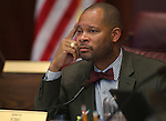 Nevada Sen. Aaron Ford, D-Las Vegas, works in committee at the Legislative Building in Carson City, Nev., on Tuesday, May 14, 2013. .Photo by Cathleen Allison