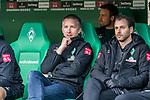 02.11.2019, wohninvest WESERSTADION, Bremen, GER, 1.FBL, Werder Bremen vs SC Freiburg<br /><br />DFL REGULATIONS PROHIBIT ANY USE OF PHOTOGRAPHS AS IMAGE SEQUENCES AND/OR QUASI-VIDEO.<br /><br />im Bild / picture shows<br />Frank Baumann (Geschäftsführer Fußball Werder Bremen) auf der Bank, <br />Dr. Daniel Hellermann (Mannschaftsarzt Werder Bremen), <br /><br />Foto © nordphoto / Ewert