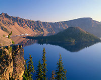 ORCL_044 - USA, Oregon, Crater Lake National Park, Sunrise glow on west rim of Crater Lake with Hillman Peak (left) and Llao Rock (right)overlooking Wizard Island.