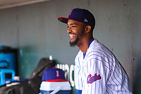 Iowa Cubs pitcher Carl Edwards Jr. (21) laughs in the dugout during a Pacific Coast League game against the San Antonio Missions on May 2, 2019 at Principal Park in Des Moines, Iowa. Iowa defeated San Antonio 8-6. (Brad Krause/Four Seam Images)