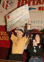Jeff King receives Wells Fargo Bank Alaska Winners purse check from Jennifer Imus