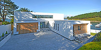 BNPS.co.uk (01202 558833)<br /> Pic: LillicrapChilcott/BNPS<br /> <br /> Modern lines...<br /> <br /> A brand new futuristic property perched right on the edge of a sea wall overlooking some of the finest sailing waters in the country has gone up for sale for £4.5m.<br /> <br /> The ultra-modern home and just been built on remote headland in the Cornish sailing village of St Just.<br /> <br /> It replaced a large bungalow that stood on the coastal plot for over 80 years and was demolished by owner and architect Callum Wason.