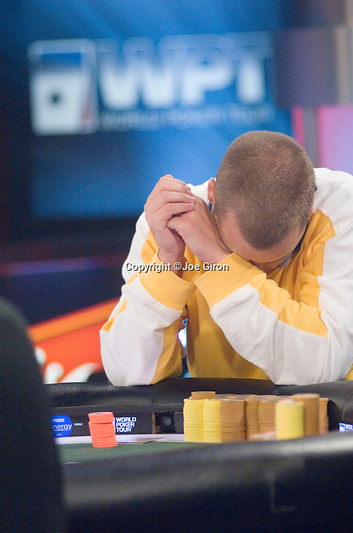 Soren Turkewitsch agonizes over his hand. He makes the call.