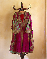 "A Cossack Coat has a cape decorated with silver braid and designed to drape over the arms, and was designed by Bakst for the Ballet ""Thamar"" in 1912"